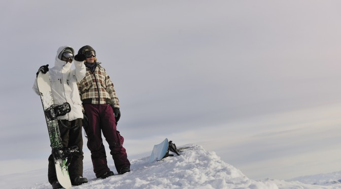 Yang lady learn how to snowboard with instructor in Austria.